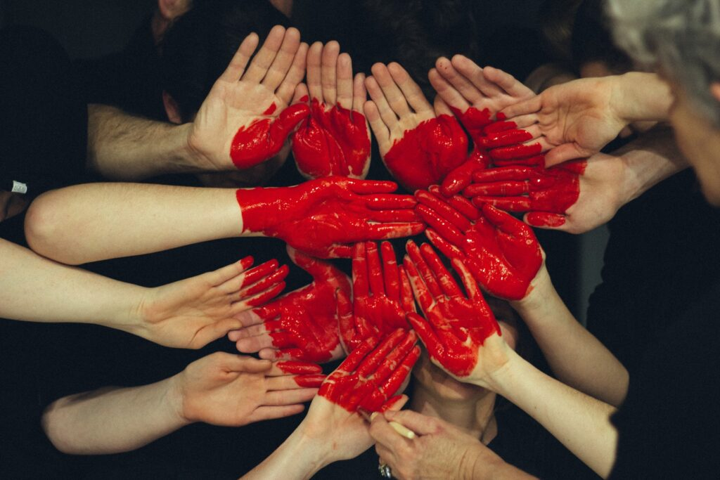 Many hands symbolising people coming together and caring and coming together to help each other with their aspergillosis.